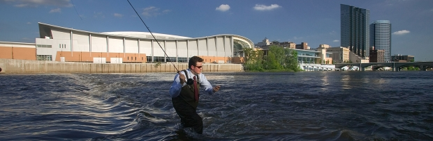 Businessman fishing Grand River