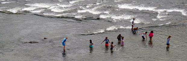 Kids Playing in Rapids